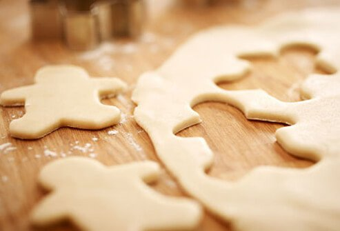 Photo of cookie cutter and dough.