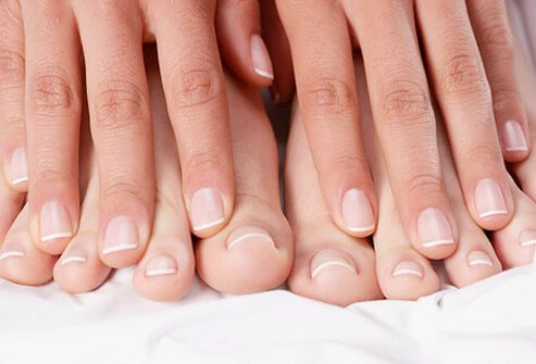 Person displaying their healthy, clean finger and toenails.