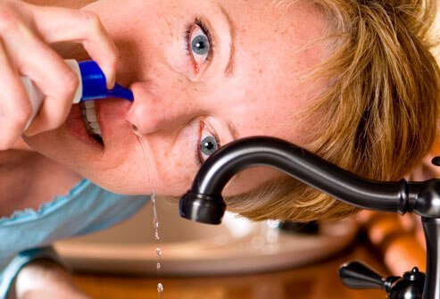 Nasal irrigation with saline solution can help relieve sinus pain and pressure.