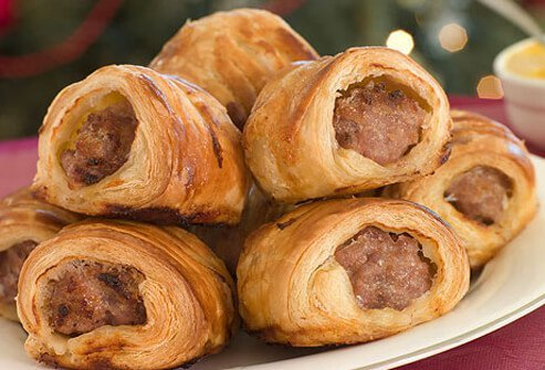 Pigs-in-a-blanket at a holiday buffet.