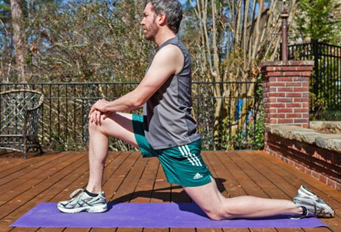 If you have low back pain, warm up by gently stretching your hips before working out.