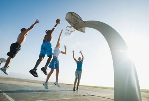 Photo of people playing basketball.