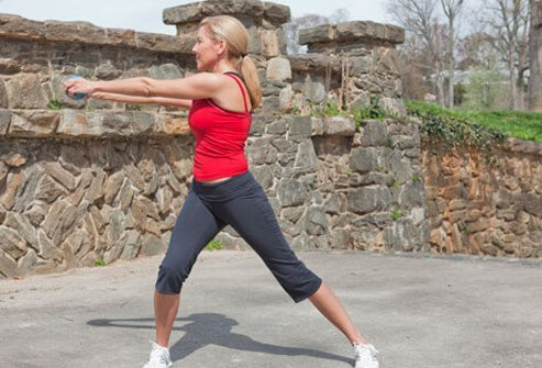 Photo of side lunge with reach.