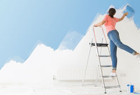 Photo of woman on ladder.