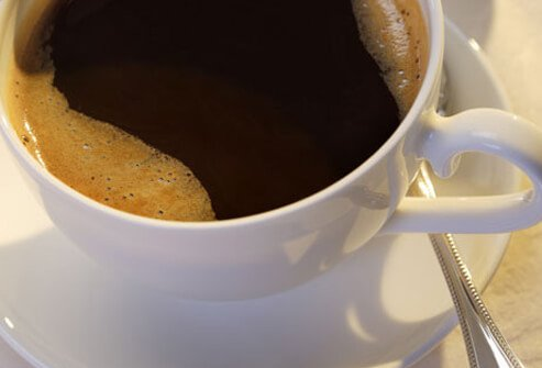 Cup of black coffee, close-up.