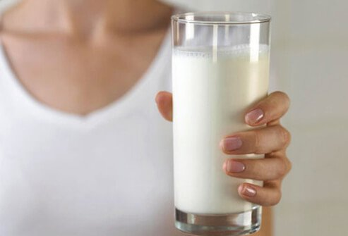 A woman with glass of milk.