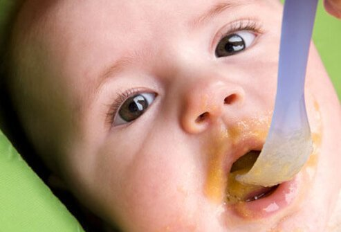 A baby eating organic food.