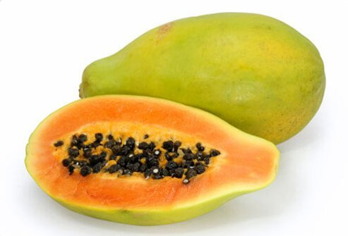 Papayas on a white background.