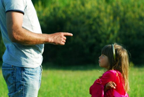 A father explains the rules to his daughter.