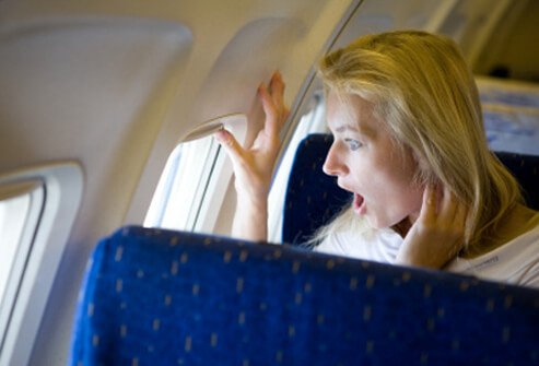 A woman with aerophobia is afraid something is wrong with the plane.