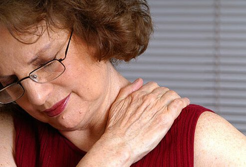 Photo of a woman with neck pain.