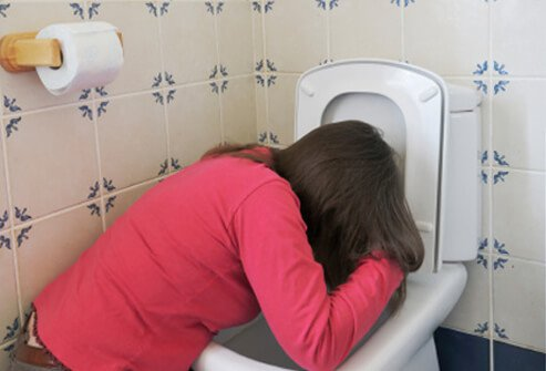 A woman experiences nausea and vomiting due to morning sickness.