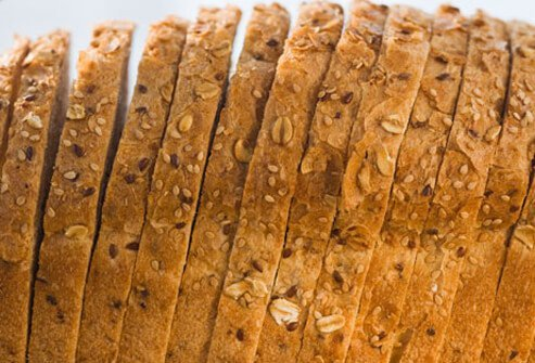Complex carbohydrates, such as whole-grain breads and cereals, are packed with fiber.