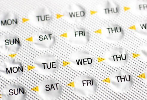 Birth control pills prevent ovulation by regulating hormones.