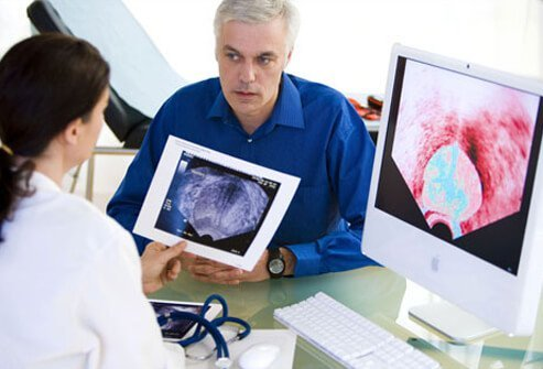 Photo of doctor discussing prostate exam results.