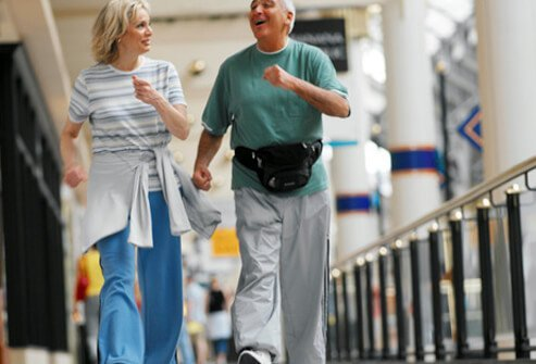 Senior couple exercising by walking.