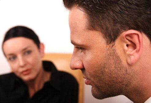 A doctor uses cognitive behavioral therapy (CBT) intervention with a patient.