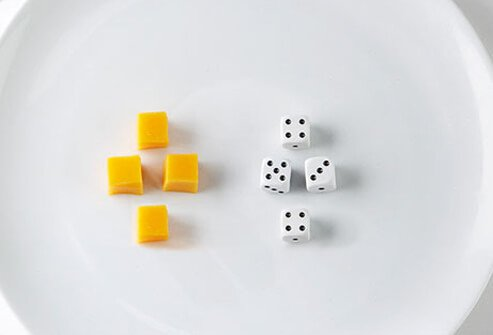 Photo of cheese and dice.