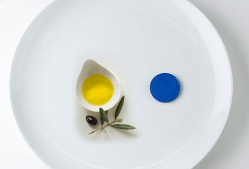 Photo of olive oil and poker chip.