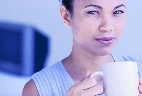 Photo of woman with mug.