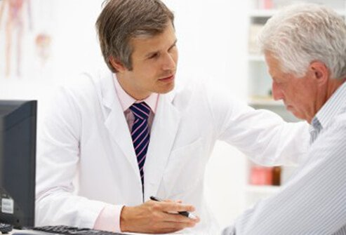 A doctor discusses shingles treatment options with a patient.