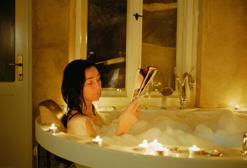 Woman relaxing in the bath, a good way to sleep better.