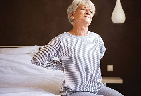 If you have back pain, sleeping on your stomach or back may aggravate your pain.