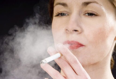 smoking effects on skin. A woman smoking.