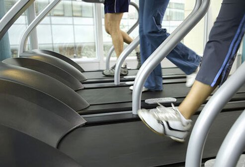 People exercising on treadmills.