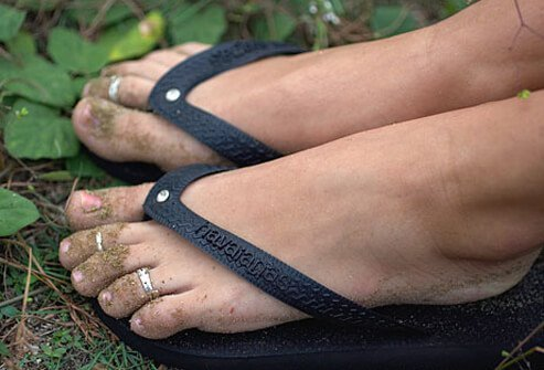 Close-up of woman's feet wearing flip-flops