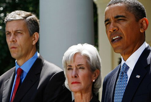 U.S. President Barack Obama (right) makes a statement from the Rose Garden with Education Secretary Arne Duncan (left) and Health and Human Services Secretary Kathleen Sebelius (center) on the 2009 H1N1 flu virus.