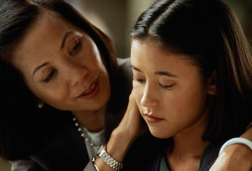 A mother talks to her daughter.
