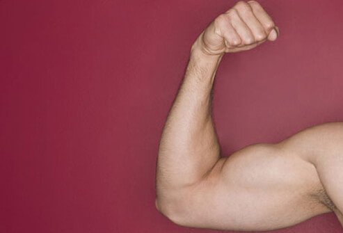 Photo of muscular arm.