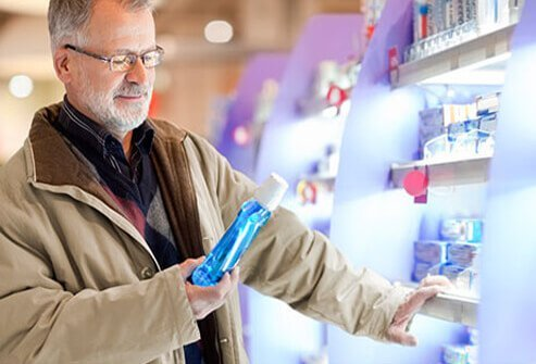 A man shopping for whitening rinses.