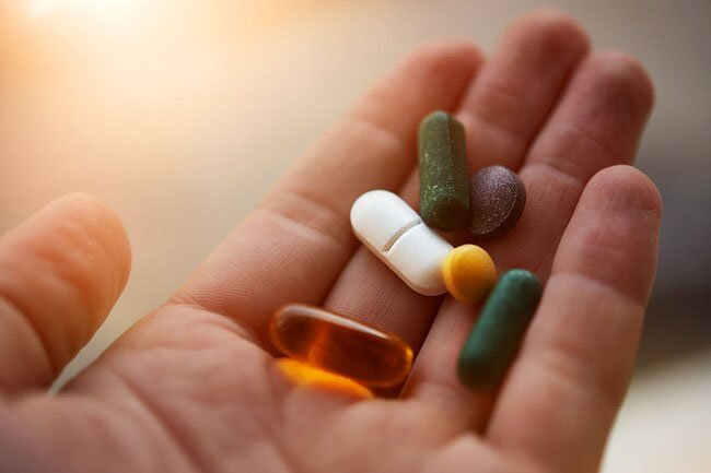 Excess B vitamins may cause urine to have an odor and change color.