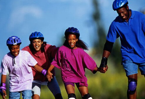 Photo of a family rollerblading.