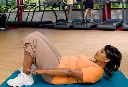 Photo of a woman exercising on a yoga mat.