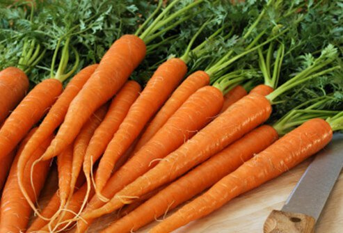 Eat vitamin A-rich carrots in addition to using healthy hair products.