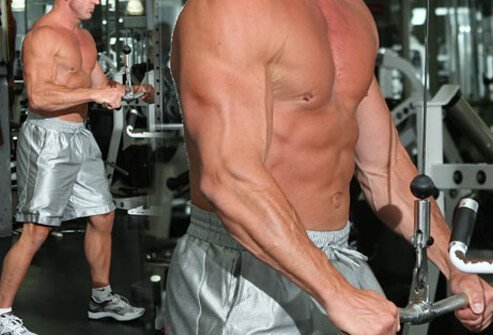 Photo of a man doing a triceps pushdown.