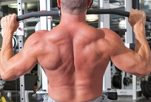Flexed back muscles in a wide grip pulldown.