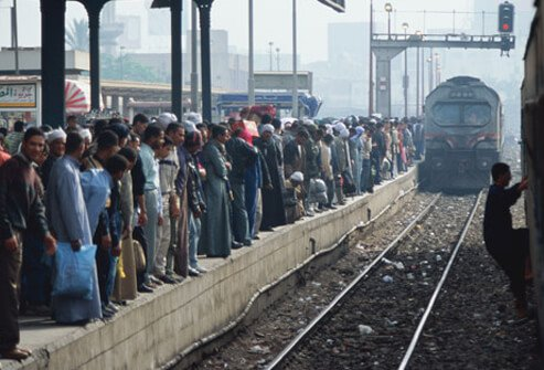 Photo of people waiting for a train.