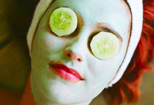 Photo of woman wearing cucumber mask.