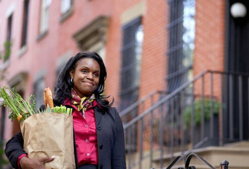 Photo of woman holding groceries.