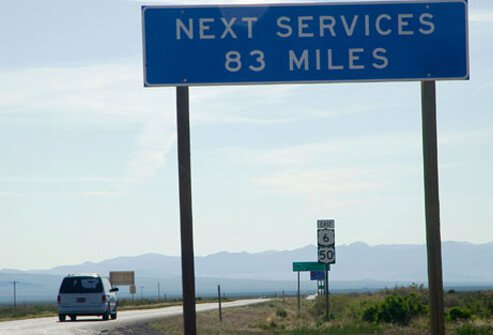 A sign displaying miles to the next service stop.