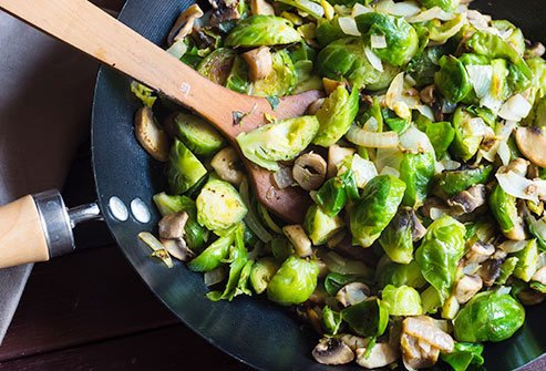 Brussels sprouts with onions, garlic, and olive oil are a tasty source of protein.