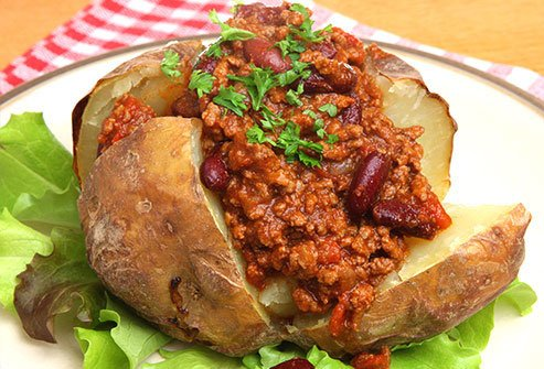 Baked potatoes topped with chili and low-fat ground turkey or tofu crumbles are packed with protein.