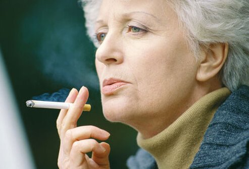 An older woman smoking.
