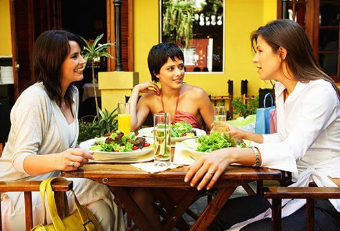 Three women having a healthy lunch at a restaurant.