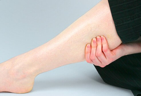 Photo of a woman pulling her muscle to relieve a charley horse.