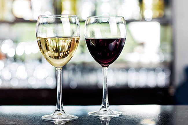 The difference between white wine and red wine is that white wine is fermented without the skins, and red wine is fermented with them.